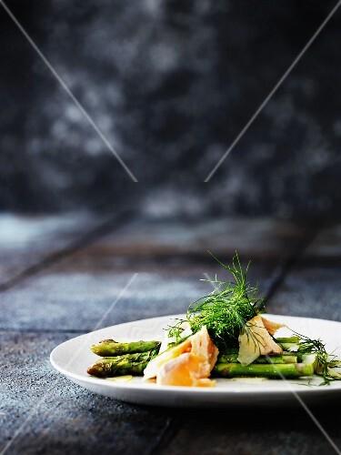 Steamed salmon on green asparagus
