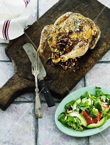 Stuffed roast chicken with a blood orange and avocado salad