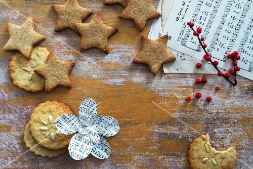 Various different Christmas biscuits and sheet music
