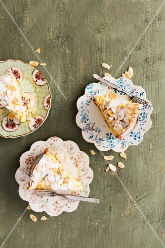 Three slices of almond cake with icing sugar