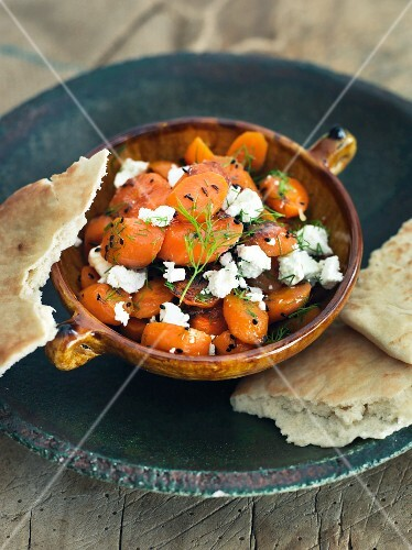 Carrot salad with sheep's cheese and unleavened bread