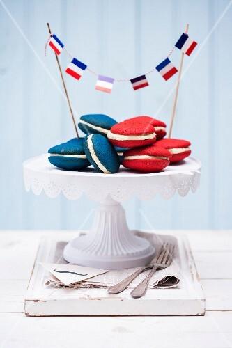 Red and blue whoopie pies filled with cream cheese frosting