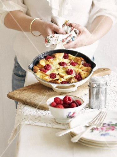 Bread pudding with raspberries in a pan