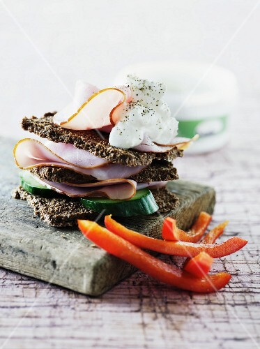 A wholemeal sandwich with ham and cucumber