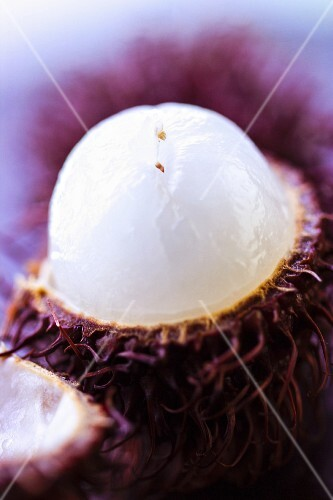 A close-up of an opened rambutan