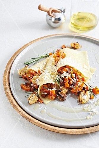 Open pumpkin ravioli with fried rosemary and coffee oil