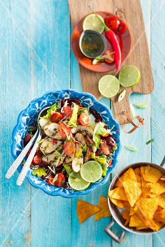 Chicken salad with kidney beans, cherry tomatoes and limes (Mexico)