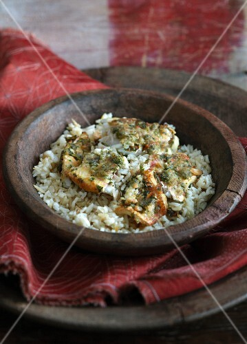 Herb fish on a bed of rice (India)