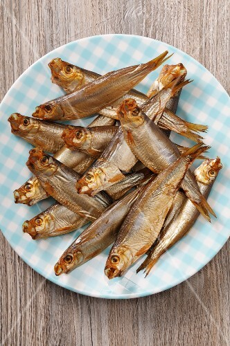 Smoked sprats on a plate (seen from above)