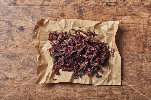 Dried flower petals on a piece of crumpled paper