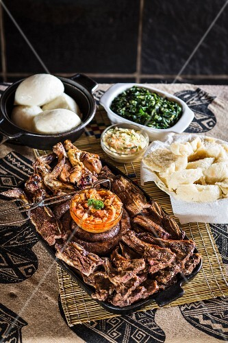 A grill platter with side dishes
