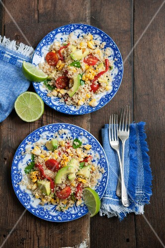 Quinoa salad with grilled corn, avocado, tomatoes, chilli, peppers and limes