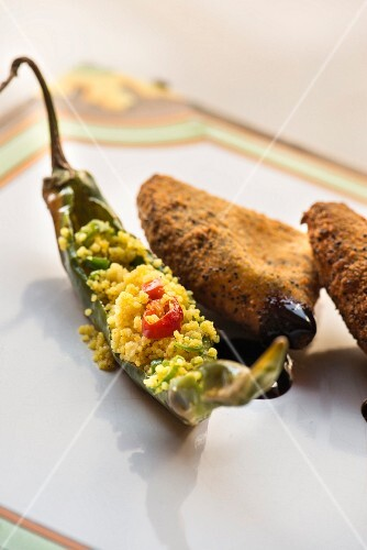 A fried friggitello pepper filled with turmeric couscous and Caciocavallo cheese with a poppyseed crust from the restaurant Farmacia dei sani in Ruffano, Italy