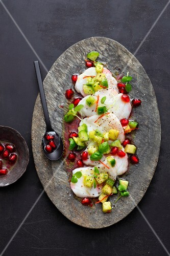 Oriental monkfish carpaccio with pomegranate seeds and avocado