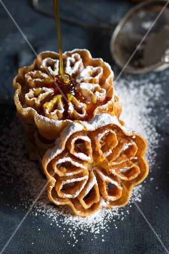 Swedish rose shaped waffles with honey and icing sugar