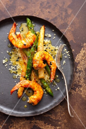 Asparagus with a passion fruit vinaigrette and king prawns