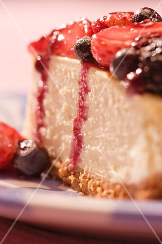 A slice of moist berry cheesecake