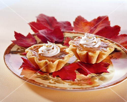 Pumpkin tartlets on autumn leaves