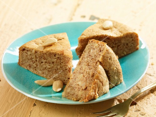 Three slices of almond cake on a plate