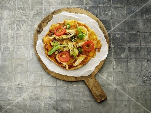 A chicken, tomato and pizza