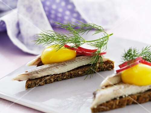 Smorrebrod top with herring and radishes