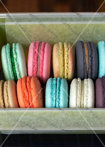 Various different coloured macaroons in a box