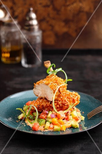 Chicken breast with a spice coating on a watermelon and tomato relish