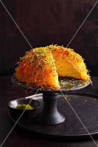 Spiced quark cake covered with kataifi pastry