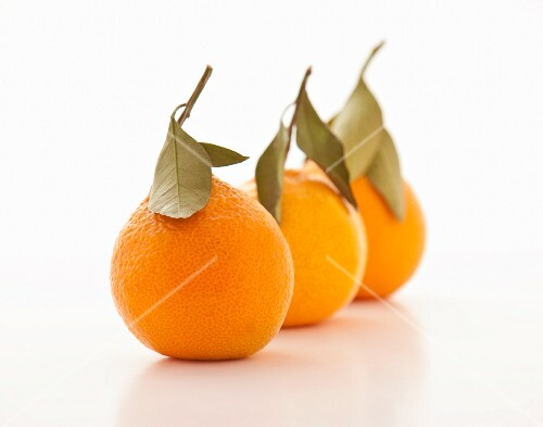 Three mandarins with leaves