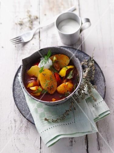 Potato and pepper goulash with fresh mugwort