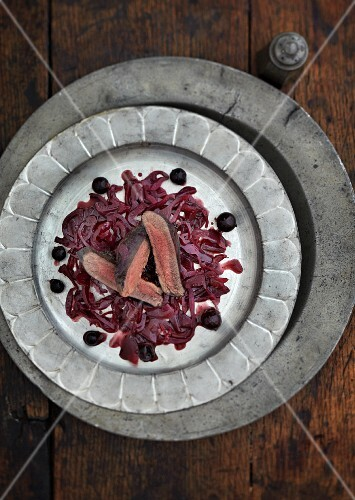 Pigeon breast on a bed of red cabbage