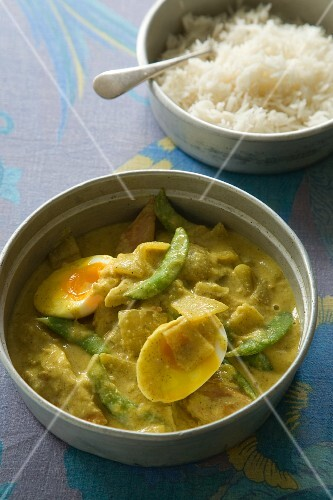 Potato curry with egg and a side of rice