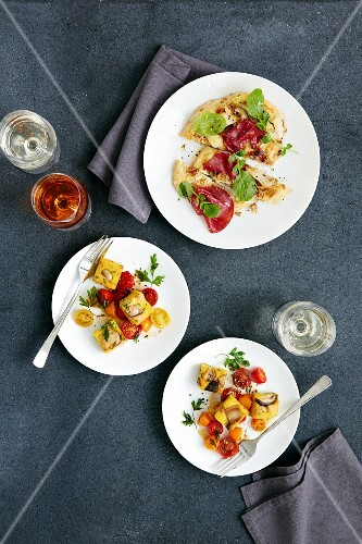 Diced polenta with mushrooms, and focaccia with bresaola and porcini mushrooms