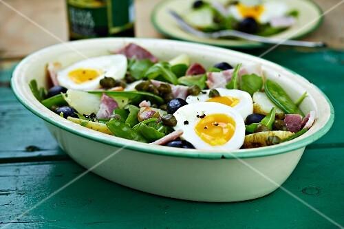 Salad Niçoise with olives, tuna fish and egg