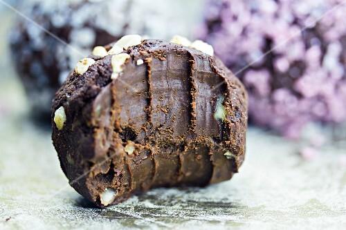A half eaten truffle praline (close-up)