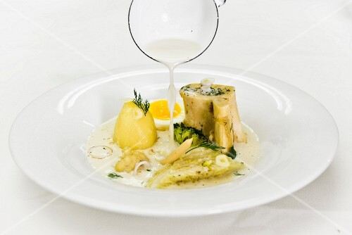 White borscht with white cabbage, potatoes and egg