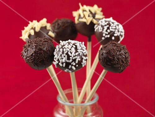 Cake pops with chocolate sprinkles and nuts