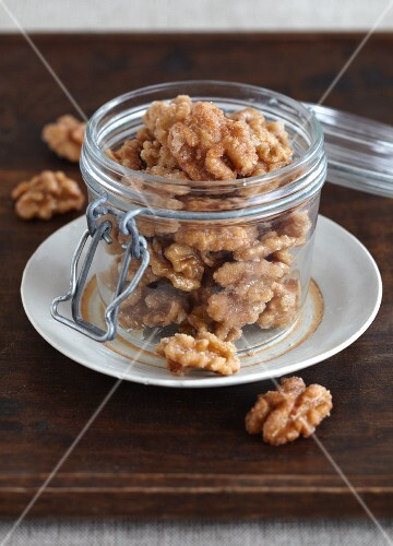 Candied walnuts in a preserving jar