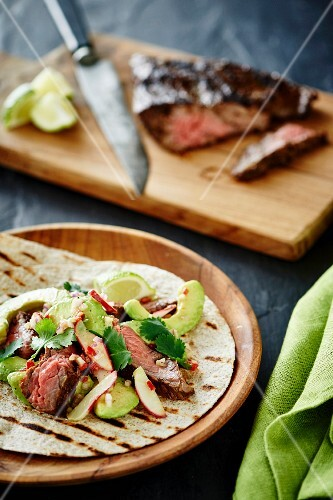 Tortillas with avocado salad and grilled beef steak