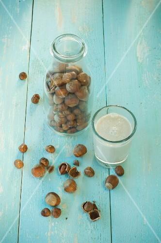 A glass of hazelnut milk with hazelnuts