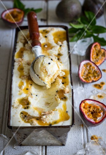 Passion fruit cheesecake ice cream with a scoop