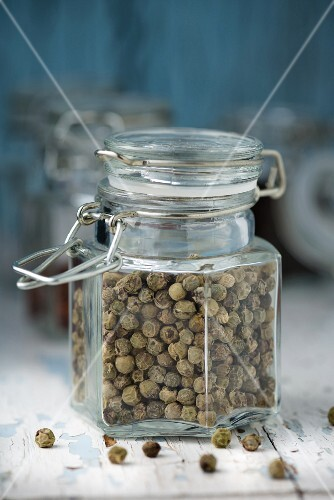 A jar of dried peppercorns