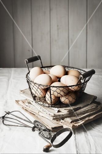 Fresh hens' eggs in wire basket