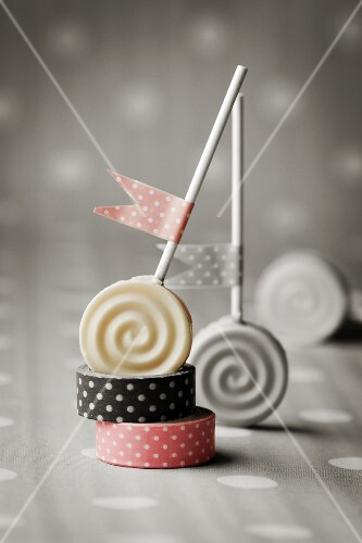 Carrot lollies decorated with polka dot flags