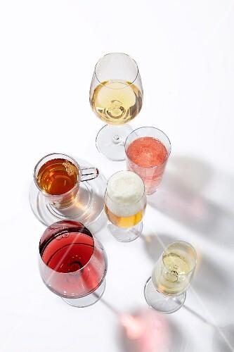 Tea, lemonade, beer, wine and cider in glasses