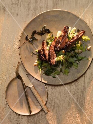 Thai style veal on a celery salad