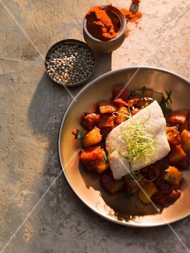 Oriental zander on a potato and pepper goulash