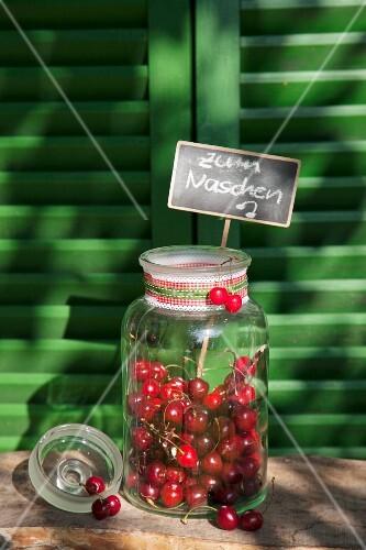 Cherries in sweet jar with chalkboard sign
