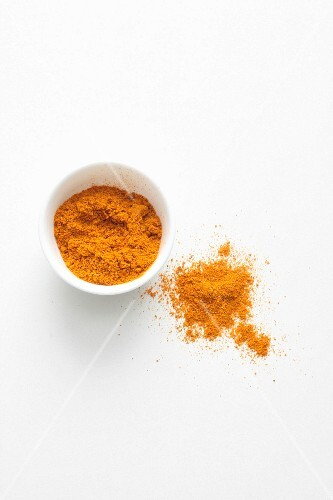 Curry powder in a dish and next to it