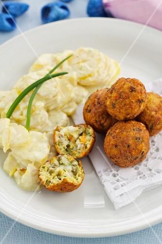 Fish balls with a mayonnaise and potato salad